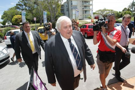 Clive Palmer arrives for the declaration of the Fairfax vote at the AEC office in Maroochydore in 2013.