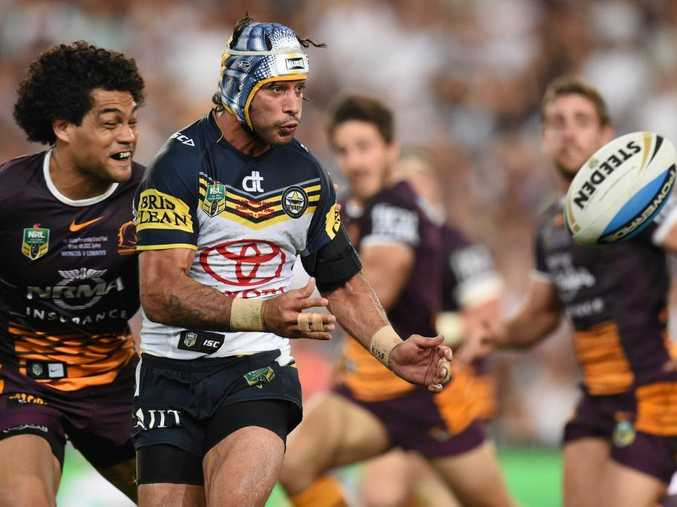 That man ... Johnathan Thurston in action during the NRL Grand Final between the Brisbane Broncos and the North Queensland Cowboys at ANZ Stadium. Photo: AAP Image/Dean Lewins.