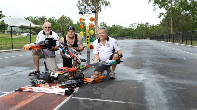 Queensland Model Drag Racing Association president Marty Armstrong, vice-president Mitch Eager and veteran member Stewart Low promote the open day at Camira next weekend. Photo: Rob Williams / The Queensland Times