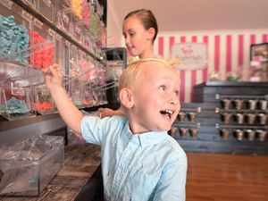 Fletcher's pumped as parents open their own lolly shop