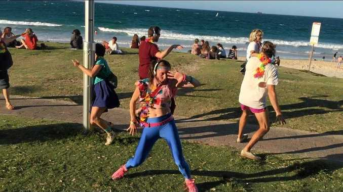 One of the revellers in the first ever Silent Disco Tour in Byron Bay's Main Beach.
