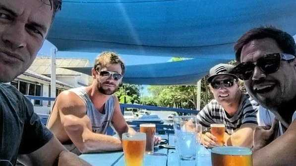 Chris Hemsworth (second from left) muscled up to the Sedgers Reef Hotel at Iluka with his brother Luke and two mates.