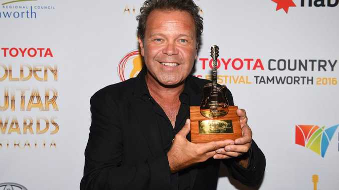 Troy Cassar-Daley poses for a photograph after winning the Golden Guitar for Single of the Year, at the 44th annual Golden Guitar Awards in Tamworth.