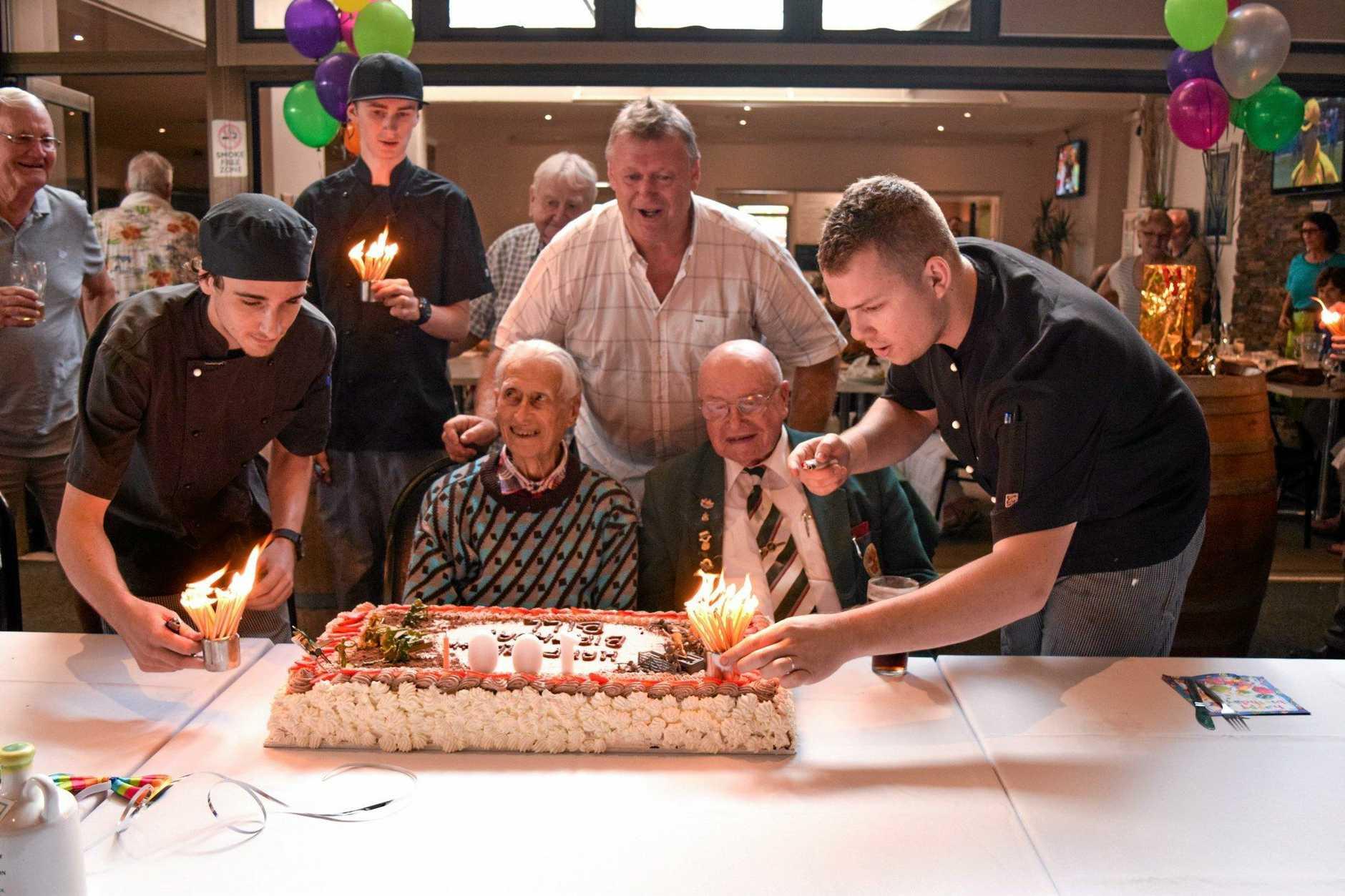 BIG BASH: Coffs Hotel chefs putting the candles on birthday boy, Bill Owers' birthday cake.
