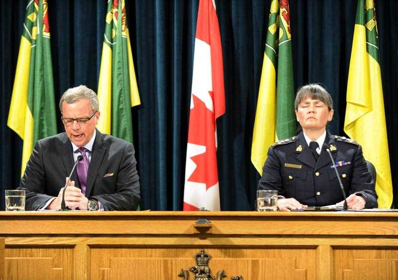 Saskatchewan Premier Brad Wall, left, and Royal Canadian Mounted Police Commanding Officer Brenda Butterworth-Carr are seen at a news conference in Regina on Saturday, Jan. 23, 2016. They were commenting on the shooting in La Loche, Saskatchewan, on Friday.