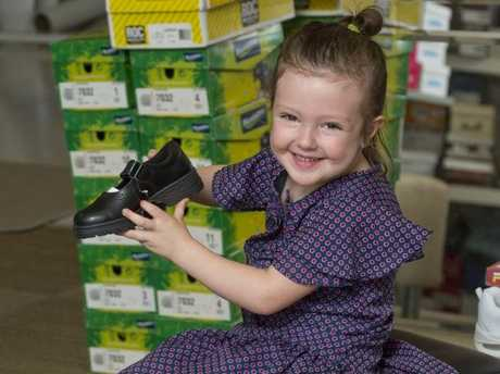 NEW SHOES: Calla Moloney tries out new school shoes at Outboxx Footwear.