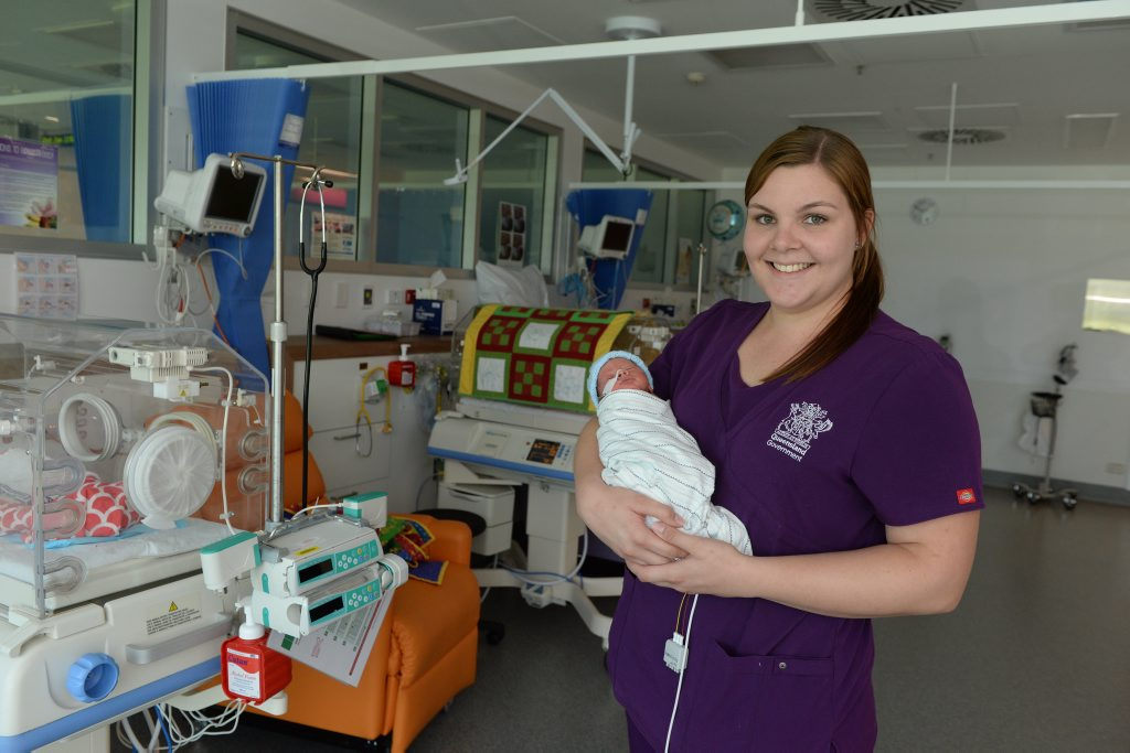 Mackay Base Hospital Neonatal Nurse Jennifer Zarzecki with premmie baby Chase Watson, who was born at 33 weeks gestation and is only seven days old. Photo Lee Constable / Daily Mercury