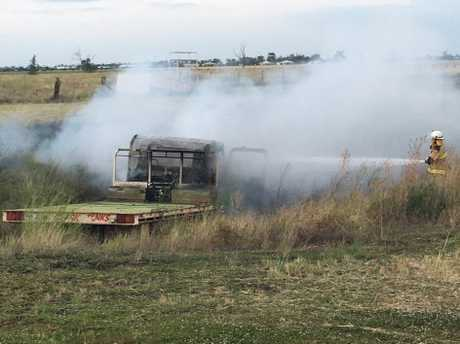 IN ASHES: A truck registered to Clark Tanks was found early Monday morning in flames dumped at a dam in Winton Street.