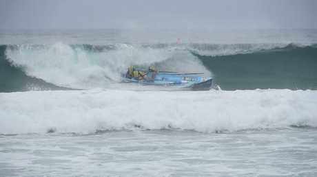 Surf rowers are battered by tough conditions at Manly at the Australian Surf Rowers Leavue Series.