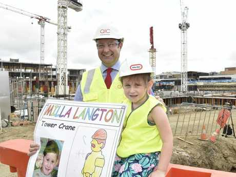 MY CRANE: Milla Langton has her drawing selected for the latest crane in the QIC development and proudle shows Grand Central centre manager Shaine Beverage