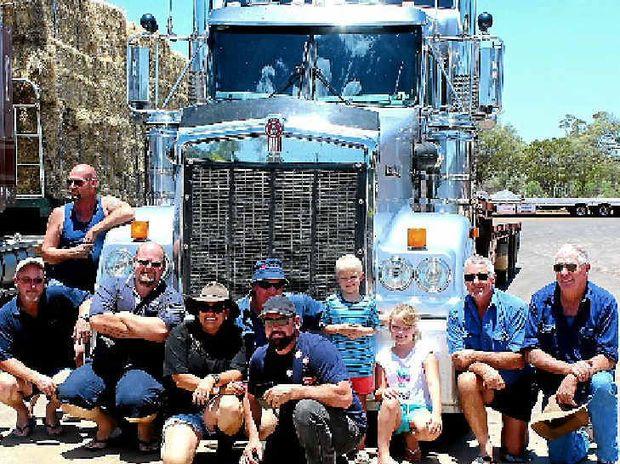 NICE SURPRISE: Hay run truckies pose with Wendy Burtenshaw, Bo and Toby Gattera.