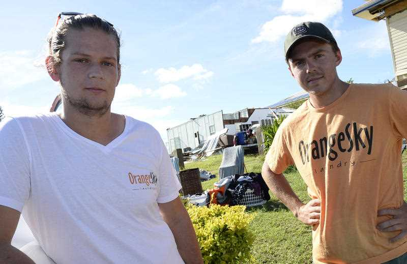 Orange Sky Laundry co-founders Lucas Patchett (L) and Nic Marchesi have arrived in Yeppoon, Sat. Feb. 21. 2015 to help people impacted by Cyclone Marcia. The pair operate a free mobile laundry service that usually help the homeless, but is also used in disaster situations.