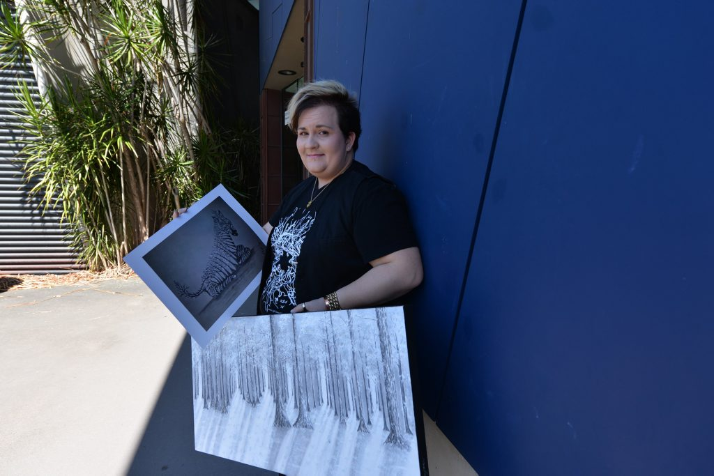 Artist Nekea Blagoev with the artwork' In-disguise' that was uploaded and shared online, and 'Frozen'. Photo Lee Constable / Daily Mercury