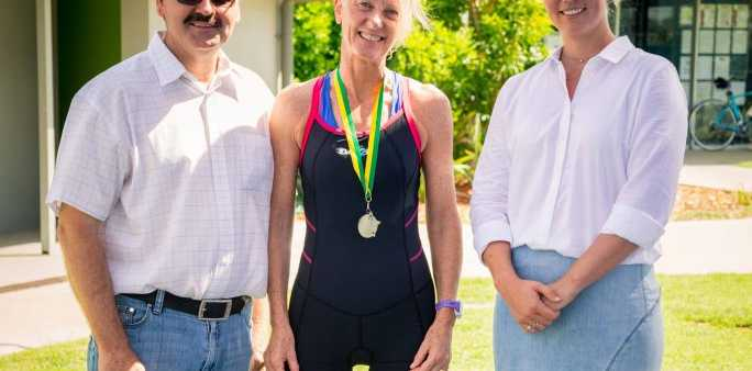 Open Women's winner of the Isaac Australia Day triathlon Robyn Kouw with Cr Peter Freeleagus and Cr Kelly Vea Vea. Photo: Contributed