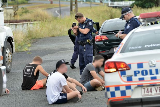 QUICK WORK: Police searched five young men in Tozer St, after intercepting a blue Holden Astra, said to have been seen leaving the fight scene after a Mt Pleasant Australia Day brawl.