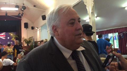 Clive Palmer has denied using an alias to run Queensland Nickel
