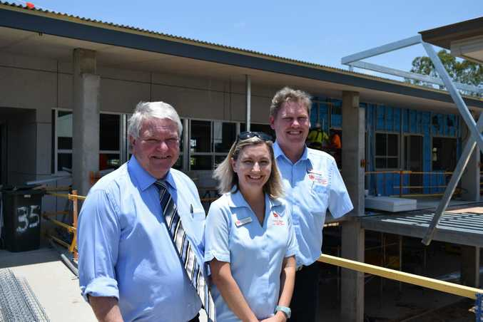 Federal Member for Flynn Ken O'Dowd inspects the conscruction of new classrooms at Trinity College with Principle Trish Hodgson and business manager Murray Schoenfisch. Photo Declan Cooley / The Observer