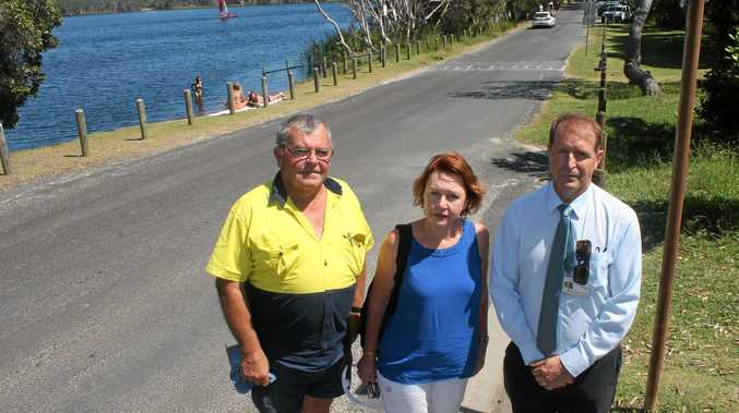 KEEP THE ROAD OPEN: Members of the Stop the Lake Road Closure Committee (from left) Dave Hulm, Jeanette McDevitt and Pip Carter have collected 1300 signatures on a petition to keep the road on the eastern side of Lake Ainsworth open.Photo Graham Broadhead / Ballina Shire Advocate