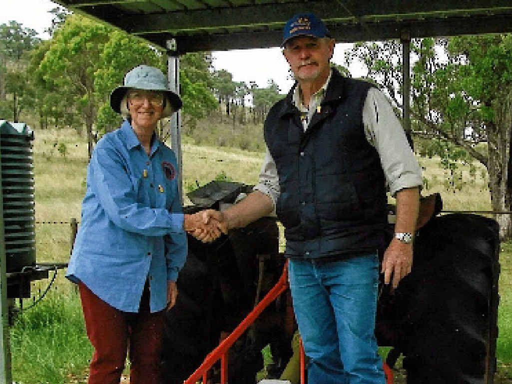 HANDOVER: Southern Downs club treasurer/secretary Margaret Taylor with Cr Ross Bartley.