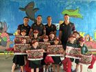 Warra State School students happy with their signed posters.