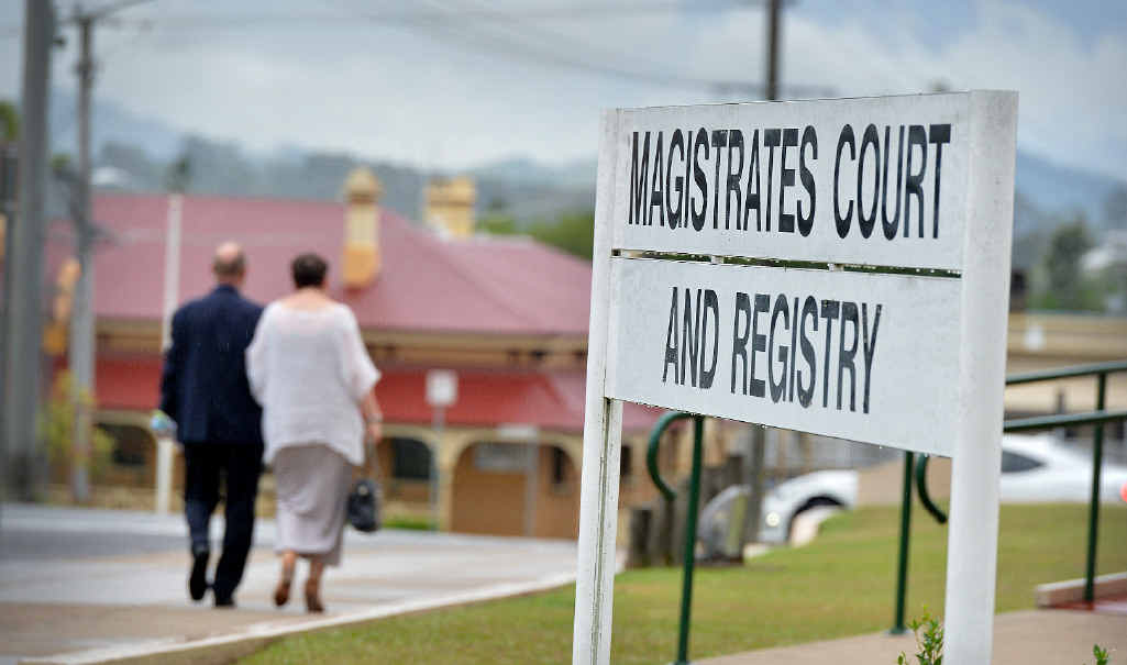 FREEDOM: Michael Hartley leaves Gympie Magistrates Court with his wife after his acquittal yesterday.