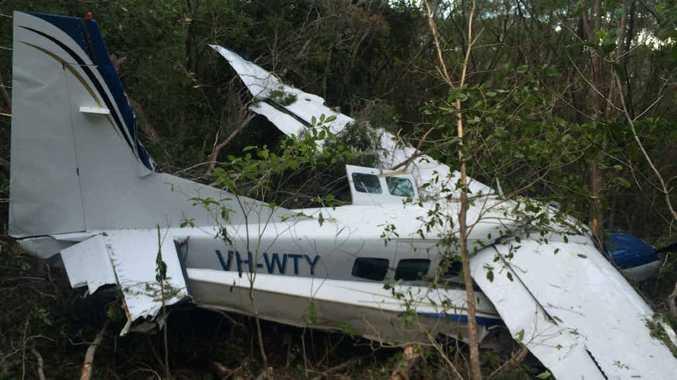 Whitsunday Air Services aircraft that crash-landed in the trees on Whitsunday Island near Chance Bay on Thursday afternoon. There had been 11 people on board; 10 passengers and the pilot. One woman was transported to hospital as a result of the crash.
