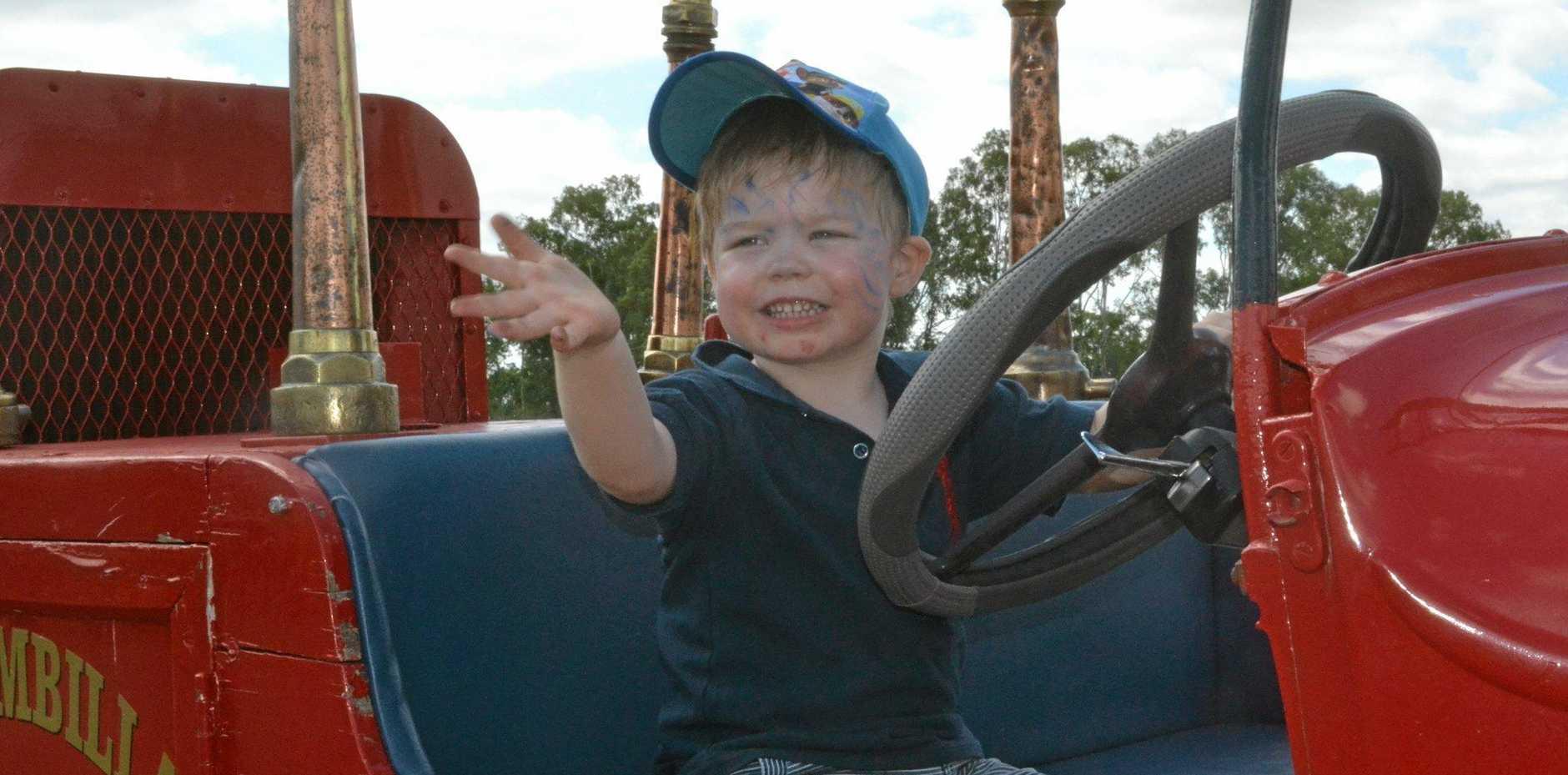 Henry Ditchburn loves riding the Wallumbilla fire truck on Australia Day.