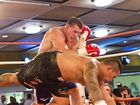 Paul Gallen ( left ) and Hermann Ene-Purcell fight it out in Toowoomba .