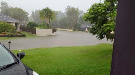 Higgins Storm Chasing posted this image of flash flooding in one street in Tewantin near Noosa.