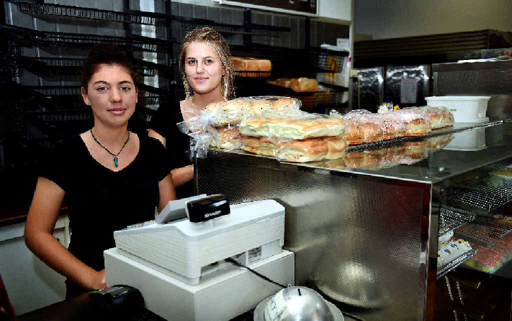 SO LOW: Top of the Bay Bakery shop assistants Bella Torres and Emma Van Kalken were left questioning who would steal charity money.