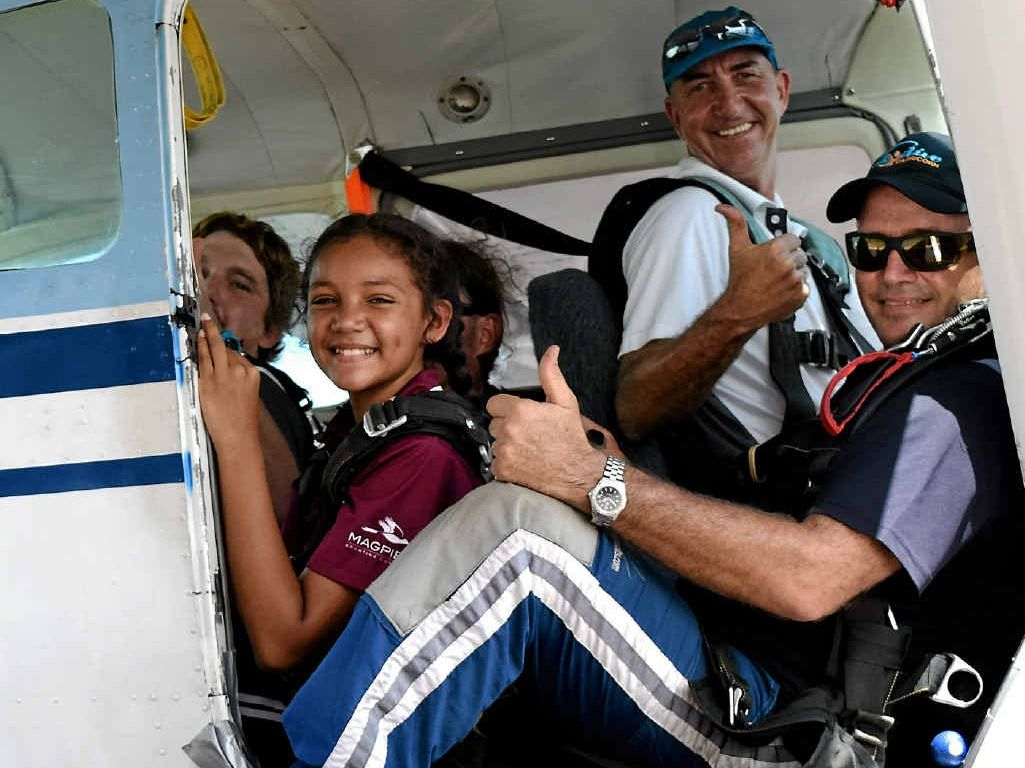 BUCKLE UP: Nerves are flying for Louvaro Kerwin who was moments away from taking off for her jump with Mackay Skydive chief instructor Lloyd Cofield (right) and pilot Gavin Norsworthy.