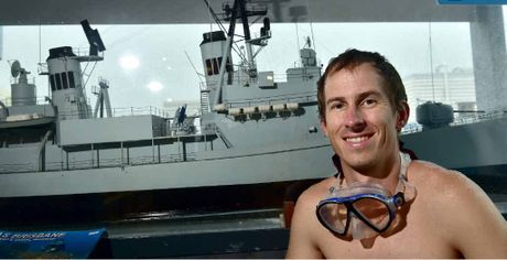 LEFT: Mike McKinnon of Scuba World Mooloolaba is excited at the prospect of another ship being scuttled of the coast. RIGHT: Mike with baitfish inside the wreck of the ex-HMAS Brisbane.