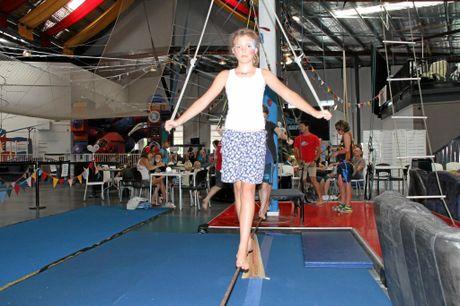 Jordja Hamilton, 11, of Alstonville, walks the tightrope at Circus Arts open day.