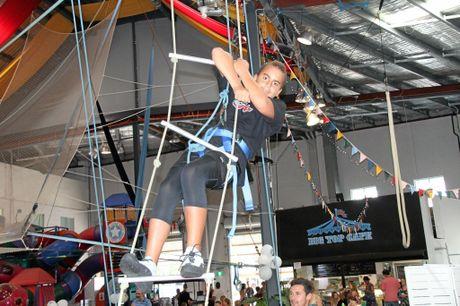 AIMING HIGH: Jiah Blair, 13, of Byron Bay, tackles a ladder climb at Circus Arts open day.