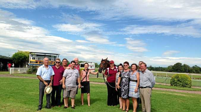 GOOD THING: Some of Bancroft's owners including John Bancroft, third from left, following the four-year-old's win at Lismore on Saturday.