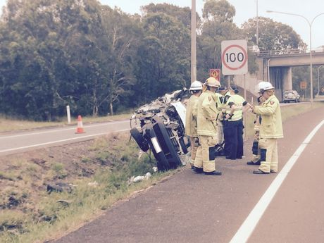 The scene on the Sunshine Motorway, Mooloolaba, where a vehicle has rolled.