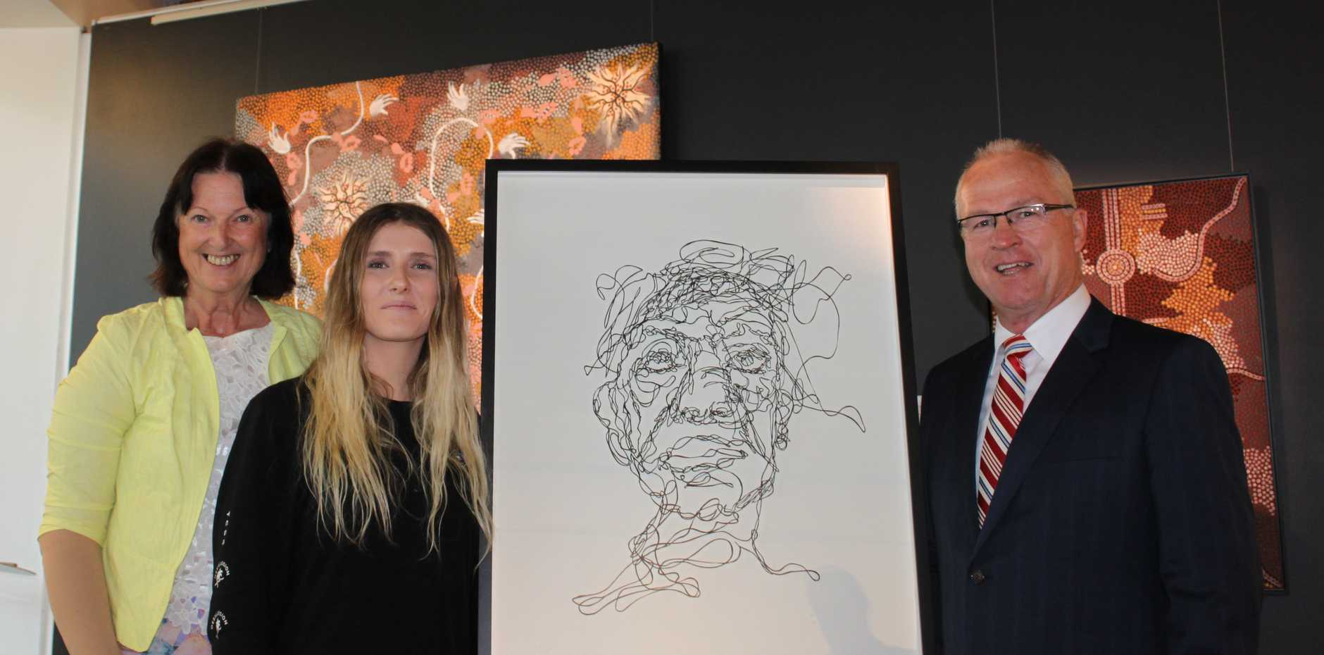Cr Jenny McKay, Sunshine Coast Art Prize 2015 Highly Commended artist Jamie Rochester, Mayor Mark Jamieson.  Image courtesy of the artist and owner.