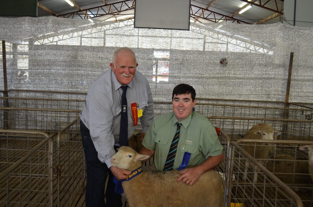 This year's prime lamb with prime lamb chief steward Jim Mitchell and judge Matty Thompson.