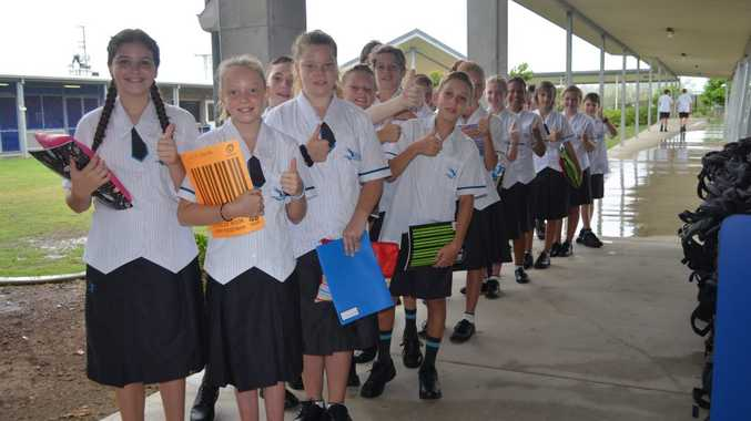 THUMBS UP - Year 7's give enjoy their first day of High School at Mackay Northern Beaches State High School.