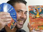 Jason Adams with his Pokemon card collection. Photo: Warren Lynam / Sunshine Coast Daily