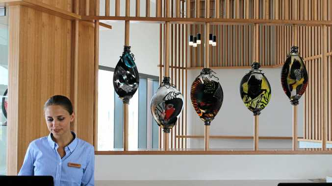 NOW OPEN: The Elements of Byron reception area, featuring blown glass works by celebrated artist Noel Hart.