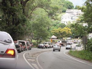 Traffic queues after concrete truck hits rail bridge