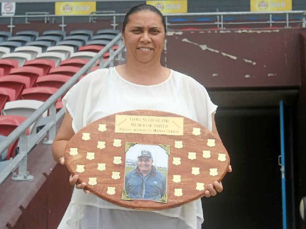 SPECIAL GAME: Blanche Sutherland displays the Greg Sutherland Memorial Trophy that will be awarded to the winner of a match between The Men of League All-Stars and the Absolute Enterprises Mackay Cutters tomorrow night.