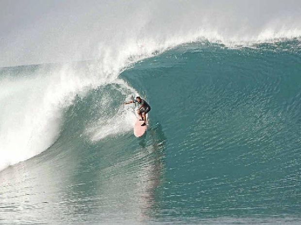 Felipe Pomar, aged 70, riding his home break on Rote, Indonesia.