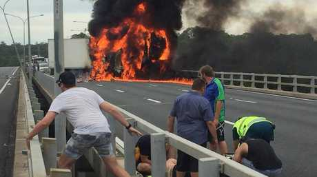The drama from the Nerang crash on the M1. Photo: Nine News / Facebook