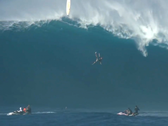 Surfer Tom Dosland falls from his board while surfing a 12m-high wave in Hawaii