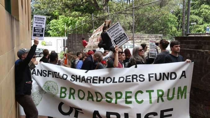 AUSTRALIA, Sydney: Protesters rally in Sydney on October 28, 2015 where the annual general meeting for Transfield, now BroadSpectrum, was being held. People arriving for the AGM were heckled and jeered before NSW Police forced protesters to move. (AAP Image/NEWZULU/RICHARD MILNES).