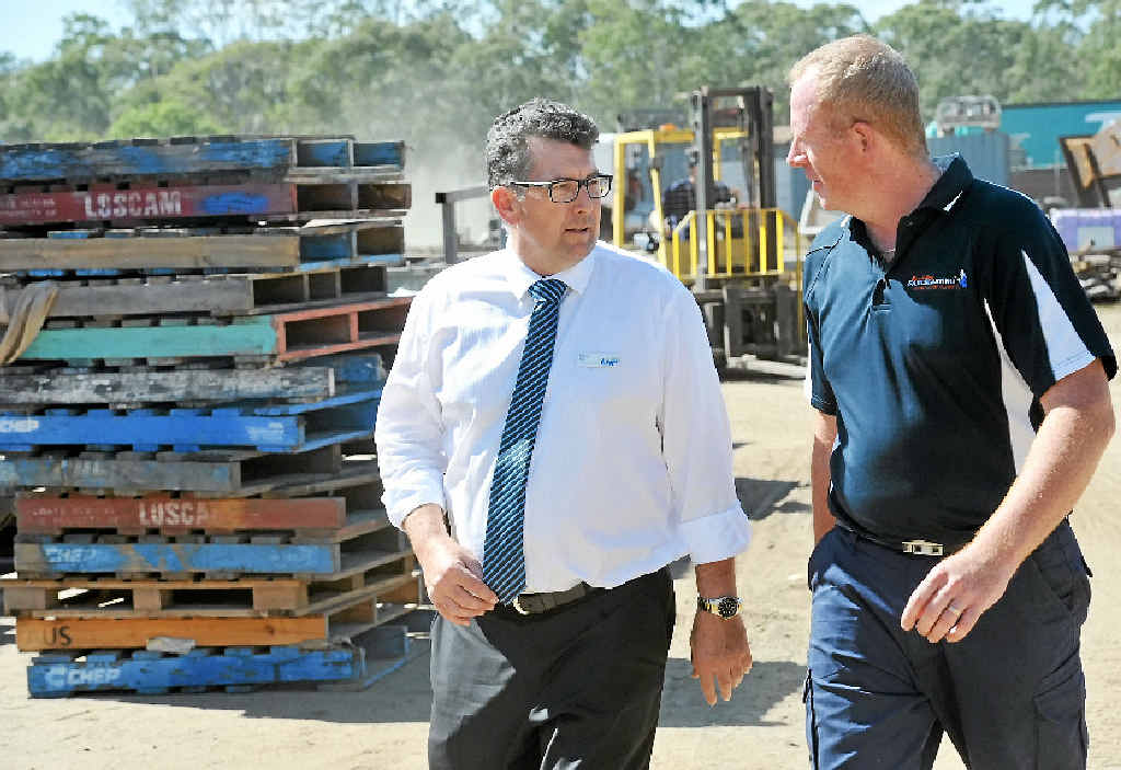 FAIR GO: Member for Hinkler Keith Pitt talks is calling for fair rules for small businesses pictured with Bundaberg Sandblasting owner Wayne Edwards (file photo).