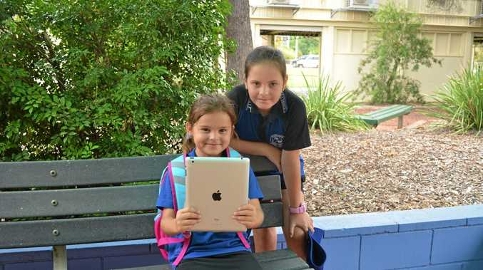 TECHNOLOGY RULES: Gabby Rylie and Destiny Holley with one of the school iPads.