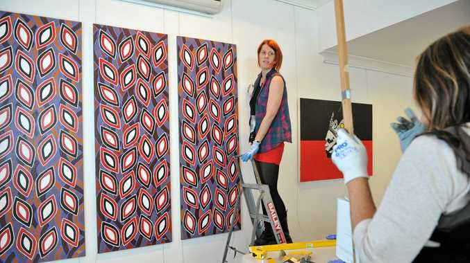 Kate Hallen and Alison Williams help to setup the Lismore Regional Gallery for the Parliament of New South Wales Aboriginal Art Prize. Photo Marc Stapelberg / The Northern Star